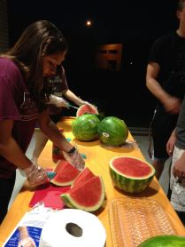 SGA members slicing watermelon
